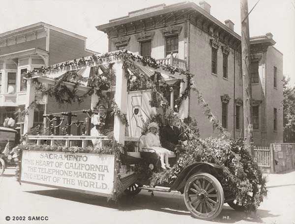 Photographic print of the Pacific Telephone and Telegraph Company automobile parade float